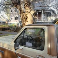 Pickup in front of Victorian house