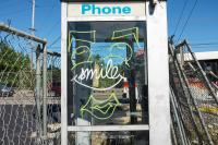phonebooth with face and the word smile