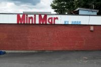 side of a Mini Mart store, mart is missing the letter t