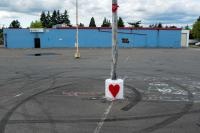 A memorial for someone in a parking lot