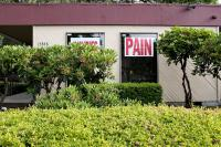 business with Pain sign in the window
