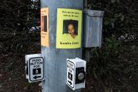 signs on crosswalk of kids who have been killed