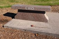 bench with the name Cho and a dead rose.