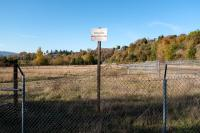 fenced land, site of old Creosoting Company