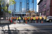 construction workers gathering for a meeting