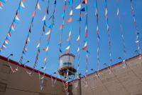 streamers with a water tower and blue sky