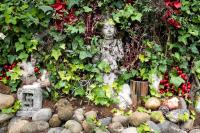 small statues by the road