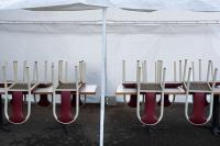 chairs put up on tables at food carts