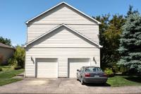 House with two car garage, without windows facing the street
