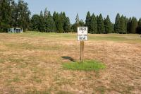 park at your own risk sign at golf course