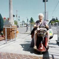Elderly woman on cart E Burnside and 122nd Max stop