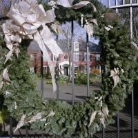Enormous wreath at gate of large estate